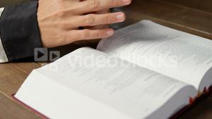 Blind woman reading a braille book