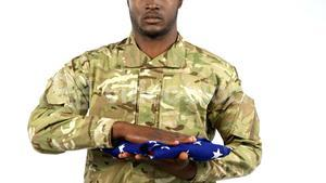 Portrait of military soldier saluting