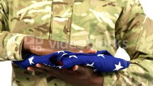 Portrait of military soldier holding US flag