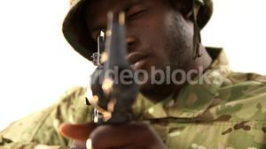 Portrait of military soldier aiming with machine gun