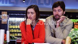 Couple ignoring each other in organic section