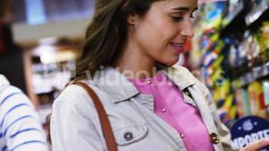 Woman shopping in grocery section