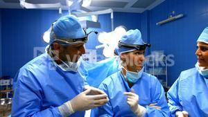 Surgeons interacting in operation room