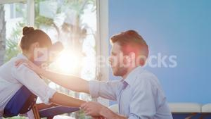 Male physiotherapist giving hand massage to female patient