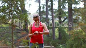 Woman adjusting a time on wristwatch