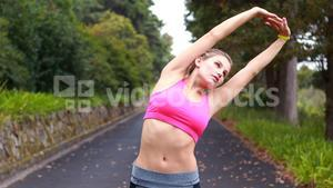 Woman exercising on the open road