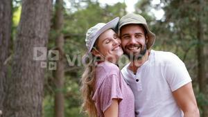 Hiker couple romancing at countryside