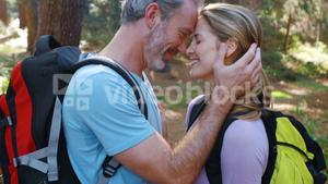 Hiker couple romancing face to face at countryside