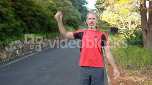Man exercising on the open road