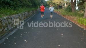 Couple jogging on the open road