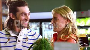 Happy couple shopping in organic section