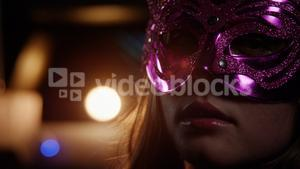 Woman wearing party mask in bar