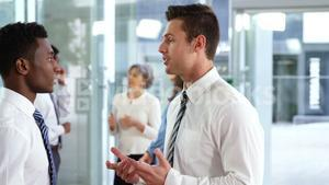 Business executives interacting in office