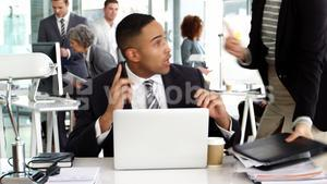 Businesspeople giving work to businessman