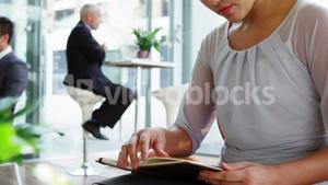 Business woman looking at diary