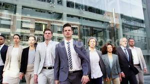 Business people walking in office building