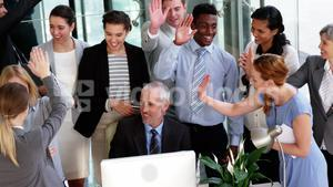 Business people giving a high five to each other