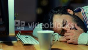 Business executive sleeping on desk