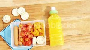 Close-up of tomatoes with sweet food and juice bottle