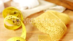 Close-up of measuring tape with lace cloth