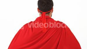 Rear view of man pretending to be a super hero