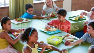 Kids having meal in cafeteria