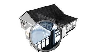 Magnifying glass examining a house. Architecture and home ownership