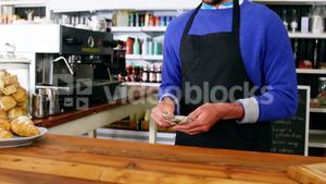 Waiter counting cash at counter