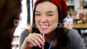 Woman having a drink with a straw