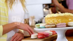 Smiling woman looking at desserts