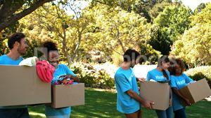 Group of volunteers holding cartons