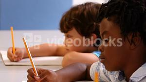 Kids studying in a classroom