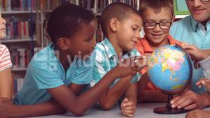 Teacher and kids discussing over a globe
