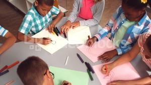 Kids drawing in paper at library