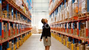 Female manager looking at warehouse
