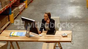 Female manager using computer