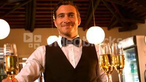 Male waiter serving a glass of champagne