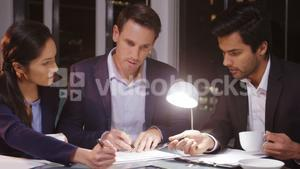 Business people signing agreement