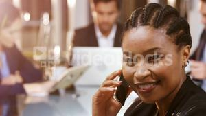 Businesswoman talking mobile phone