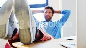 Thoughtful male business executive relaxing
