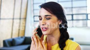 Female business executive talking on mobile phone
