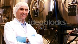 Brewer with arms crossed at brewery