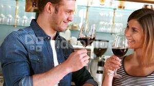 Couple toasting a glass of wine