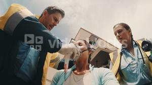 Doctor putting an oxygen mask on patient
