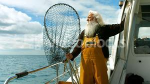 Fisherman holding fishing net