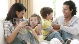 Hand choosing clips about families at home