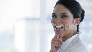 Businesswoman turning and smiling at the camera