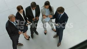 Business people using digital tablet and mobile phone