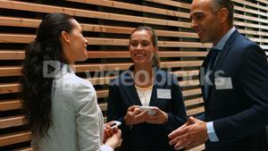 Business people interacting with each other