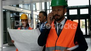 Architect talking on mobile phone